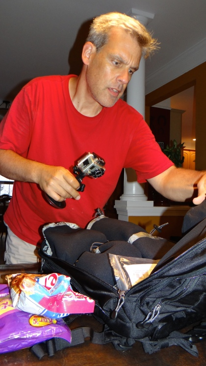 Jeff preparing his cameras and equipment bag