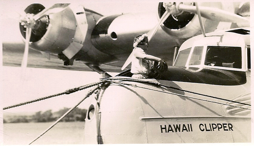 Patricia Kennedy christens the Pan Am Hawaii Clipper flying boat with coconut water in Pearl Harbor, Hawaii - May, 1936