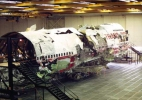 TWA Flight 800: A photograph of the right side of the large three-dimensional reconstruction, with the support scaffolding visible.
